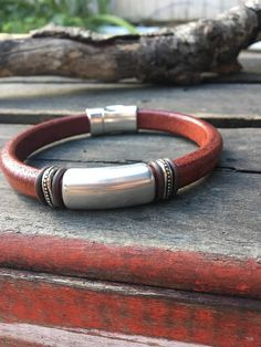 Mens Licorice Leather Bracelet made with antique silver tube and silver findings. The sturdy mens bracelet is made on 10X6mm Sandalwood Licorice leather, brown o-rings, strong magnetic clasp. Great for a birthday, anniversary or Fathers day gift Add wrist size below/) Packaged in a