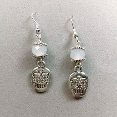 Beaded earrings with milky white briolette crystals and silver sugar skull charms, Dia de los Muertos, Day of the Dead, Halloween jewelry by StellaMagiaDesigns on Etsy