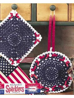 Patriotic Pot Holders  Tiny white buttons and red satin ribbon add flair to our 100 percent USA red, white and blue pot holders!  Designed by Lori Zeller  free pdf from free-crochet.com
