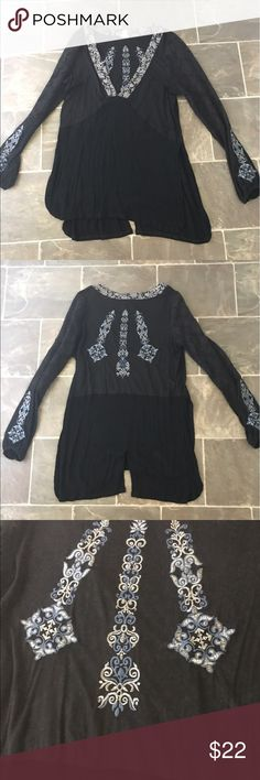 Gimmicks by bke tunic Gimmicks by bke tunic from the buckle size large. It is black mesh sleeves with slits on the sides and back. It has blue detailed stitching it has the option of a laced up neckline but I don't have the ribbon that came with it. BKE Tops Tunics