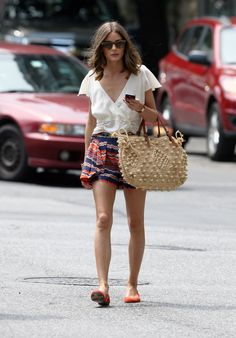 wearing Parker's origami shorts with a flutter top, crochet Gerard Darel bag and orange flats.