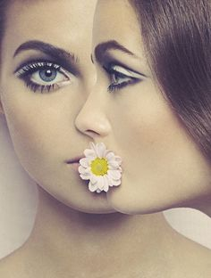 60s inspired makeup topped off with a daisy in her mouth x
