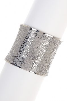 "Savvy Cie Lace Cuff $175 - $23 at HauteLook. - Lace printed stainless steel cuff - Fits up to 7.5"" wrists - Approx. 2.25"" inner diameter, 2"" width - Stainless steel"