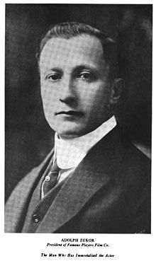 "In 1912, Adolph Zukor established Famous Players Film Company -- advertising ""Famous Players in Famous Plays"" -- as the American distribution company for the French film production Les Amours de la reine Élisabeth starring Sarah Bernhardt. The following year he obtained the financial backing of the Frohman brothers, the powerful New York City theatre impresarios. Their primary goal was to bring noted stage actors to the screen and Zukor went on to produce The Prisoner of Zenda (1913)."