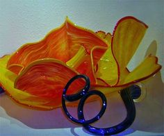 """Exquisite Colorful Glass Wall Plates, Sculptural Glass Wall Art and Glass Wall Flowers from White Elk's Visions in Glass. Work personally with the nationally recognized glass artist, White Elk, and his team to add beauty and """"Wow!"""