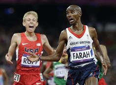Photos of the day: Britain's Mo Farah, right, crosses the finish line to win gold ahead of United States' Galen Rupp in the men's 10,000-meter final.