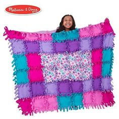Now her favorite blanket can be the one she makes herself! Using different shades of pink, purple, and blue, this no-sew quilt is an excellent idea for crafty girls. Best Gifts For Girls, Teenage Girl Gifts, Gifts For Kids, Toy Craft, Craft Kits, Baby Hug, Birth Records, Flower Quilts, Sand Crafts