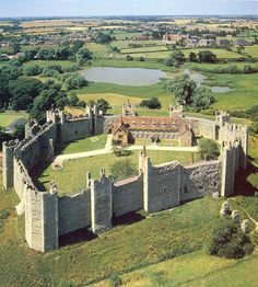 Framlingham Castle,Framlingham, Suffolk, England.http://www.castlesandmanorhouses.com/photos.htmAn early motte and bailey Norman castle was built here before 1148, but this was destroyed by King Henry II of England in the aftermath of the revolt of 1173-4. Its replacement, constructed by Roger Bigod, the Earl of Norfolk, was unusual for the time in having no keep, instead relying on a curtain wall with thirteen mural towers. The castle was taken by King John in 1216 after a short siege. By…