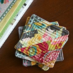 String Block Quilted Coasters/Mug Rugs --check out pins for small quilt projects, which are a great way to get your play time in without a massively daunting time commitment.you can explore creative avenues just a teense. Small Quilt Projects, Scrap Fabric Projects, Small Sewing Projects, Fabric Scraps, Quilting Projects, Sewing Crafts, Quilted Coasters, Quilted Potholders, Fabric Coasters