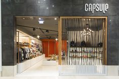 Capsule store fit-out with pure white seamless resin floor