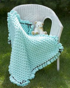 Beautiful textured blanket with ribboned and ruffled edges. Crocheted in Bernat Softee Baby.