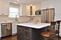 Wall Cabinets: Kountry Wood Products, Maple, White finish, Jamestown door style, Island Cabinets: BaileyTown USA, Maple, Slate finish, Chesapeake door style White Kitchen Cabinets, Kitchen Cabinetry, Wall Cabinets, Maple Kitchen, Design Firms, Slate, Wood, Kitchens, Usa