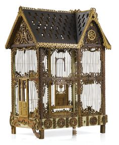 Two Victorian polychrome painted birdcages late 19th/early 20th century the first in in the form of a pagoda, the central cage flanked by circular turrets and surmounted by a spire with a metal flag; the other in the form of a house, the pitched roof with two gables, the tympanums pierced with foliate carving; the whole with pierced foliate-carved borders raised on bracket feet.