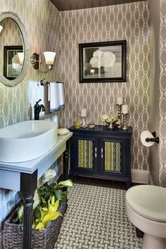 A designer bathroom with posh wallpaper from the Echo collection. Sophisticated taupe grey and silver bathroom with contemporary stylings #wallpaper #homedecor
