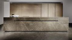 eggersmann Limestone and graphite kitchen block island, tall cupboards, oak veneer, sandblasted drawer doors and sliding doors.