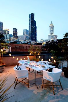 Reserved for summer months: dining al fresco on a rooftop among city lights.