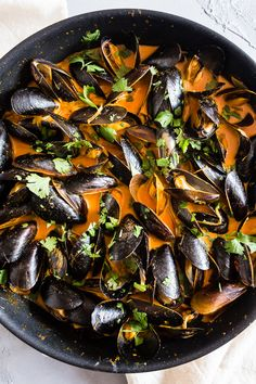 These red curry coconut milk mussels are ready in just 35 minutes and are packed full of ginger, garlic, and lemongrass flavors.