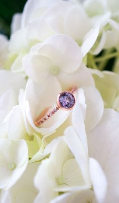 A violet sapphire engagement ring by S.Kind&Co.