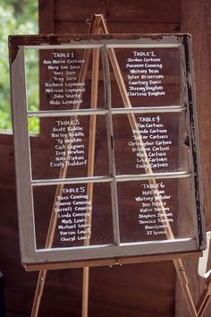 DIY Wedding Seating Chart: Their window pane wedding seating chart was displayed upon a wooden easel.