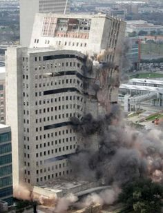 M.D. Anderson's Houston Main Building is imploded Sunday, Jan. 8, 2012, in Houston. Opened in 1952 the 20-story building was the regional headquarters for Prudential Insurance Company