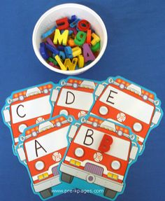 PreK & K : Let's Match the magnet letters to the Upper Case letters on the Fire Trucks
