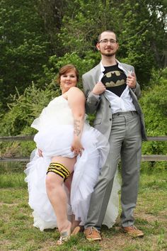 Too cute!! A bride and groom show off their batman garter belt and t-shirt for their deleware back-yard wedding
