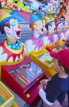 Clowns at sideshow alley, Ekka.   http://togetherweroam.com/braving-the-ekka-with-kids/