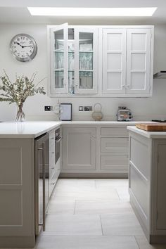 Genius for making a small kitchen feel bigger - Mirrors at back of glass-fronted wall cabinets. Great idea!