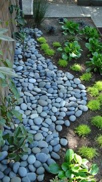 """Love the gentle curve of the rocks with shady plants."""