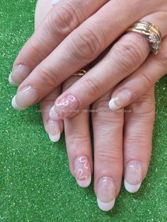 White tips with pink freehand flower nail art