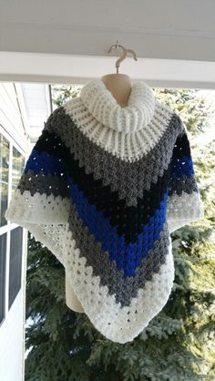 Hot Off My Hook! Project: Cowl Neck Poncho Started: 12 Jan 2016 Completed: 14 Jan 2016 Model: Madge the Mannequin Crochet Hook(s): 7mm, Cowl portion, K, Granny Stitch portion Yarn: Crafter's Secret, Bernat Super Value Color(s): Alpine Snow, True Grey, Pepper, Royal Blue Pattern Source: Simply Crochet Magazine, Issue No. 25 (Hard Copy) Pattern Designed By: Simone Francis Notes: This is my 67th Cowl-Neck Poncho!