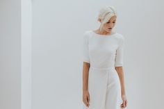 Long sleeve simple wedding dress by Charlotte Simpson