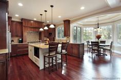 Decent approximation of what mahogany floors, nut brown cabinets, and white countertops would look like.