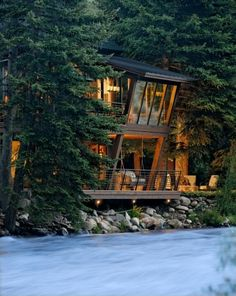 River House Glows Like a Lantern in the Woods - under deck lights give Dining Room guests a view of the river and landscape from the angular windows. Architecture by David Johnston Architects, Aspen, Colorado. - My dream home! Twilight House, Architecture Design, Angular Architecture, Windows Architecture, Modern Architecture House, Landscape Architecture, Landscape Design, Design Exterior, Rustic Exterior