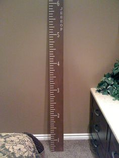 Giant ruler for measuring a child's growth...great super saturday idea