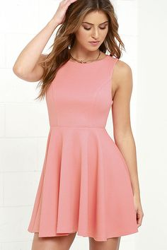 The Gal About Town Coral Pink Skater Dress is perfect for the busy girl who gets invited to everything! Textured stretch knit forms a sleeveless bodice with princess seams above a flirty skater skirt. A single gold button tops an open back. Hidden back zipper/hook clasp.