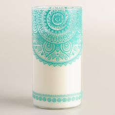 Our long-burning and highly fragranced candle comes in a glass tumbler decorated in a traditional Indian Mehendi design and is scented with Gardenia to transpor