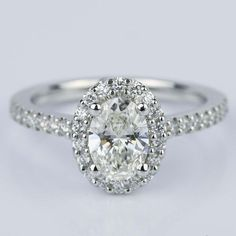 Would you say yes to this beautiful Oval Halo Diamond Diamond Engagement Ring in Platinum?