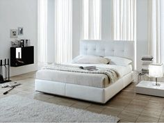 An all-white bedroom allows for rest and relaxation