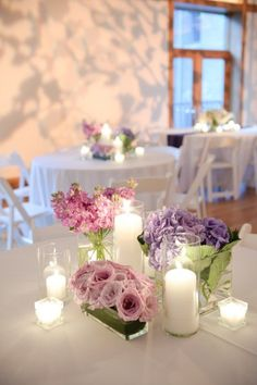 I like the use of several vases of flowers and varying heights of candles