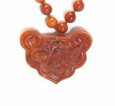 Orange Jade Carved Fish Pendant. $150.00, via Etsy.