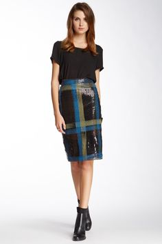"""The Grunged-Up Sequin An updated take on the ubiquitous sequin: Do it in plaid. """"I can't kick the grunge trend,"""" says Albrecht, citing her mania for anything checkered. A sequined, tartan pencil skirt has both grit and glamour — pair it with a black tee and tough booties for the ultimate anti-party-girl outfit.Nicole Miller sequin skirt. Shop similar styles at Nordstrom Rack."""
