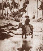 Maestra rural sobre un caballo