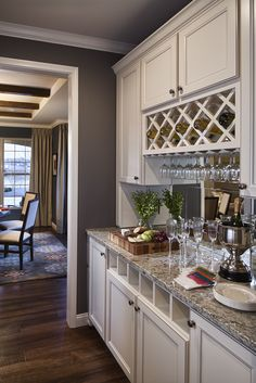 In the pantry area between the kitchen and dining room we detailed a bar area to enhance the way the dining room functions for entertaining. #kitchen #interiors #interiordesign