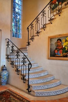 Beautiful Spanish Style wrought Iron railing on stone steps with hand painted tiles. Mexican Home Style. Home. Spanish Colonial Home Spanish Colonial Homes, Spanish Style Homes, Spanish House, Spanish Tile, Iron Staircase, Staircase Design, Spanish Revival, Style At Home, Hacienda Style Homes
