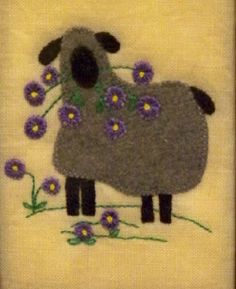 "A Sheeps Yarn ~ ""Sheep With Flowers"" by ""sewbeezy"" in Washington.  Done on a coffee-dyed linen background, it fits into a 4"" x 6"" frame.  The 12 tiny flowers were made using a tip from designer Sue Spargo, who uses tiny circles in her quilts.  She uses a 1/4"" hole punch, which made it easy to produce tiny little circles in a very short amount of time."