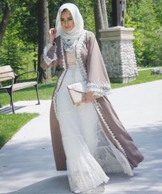 neutral abaya with lace dress- Latest Abaya designs for 2016 http://www.justtrendygirls.com/latest-abaya-designs-for-2016/