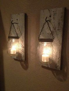 Mason jar sconces. Or scratch the wood pieces and do decorative hooks on the wall.