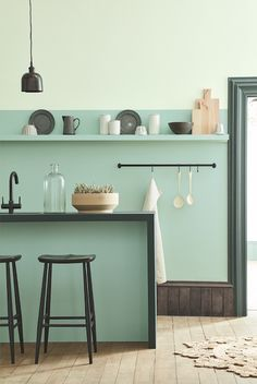 The Best Paint Colours and British Designer Paint Brands to use in your home - this beautiful painted kitchen in soft shades of aquamarine blue is modern and stylish and easy to achieve. Read the full feature for your complete guide to colour trends and the best paint to use in 2017 and 2018.