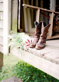 cowboy boots and a bridal bouquet